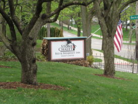stone chalet sign on front lawn